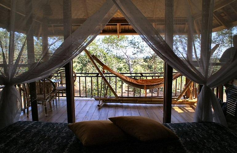 View from the bed, Kingfisher Ecolodge