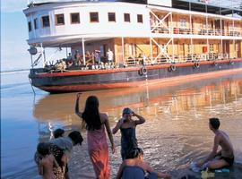Villagers watch a Pandaw Cruise pass by