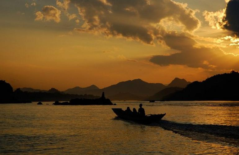 Boat on Mekong at sunset