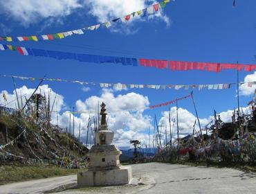 Prayer flags lining the road, Bumthang