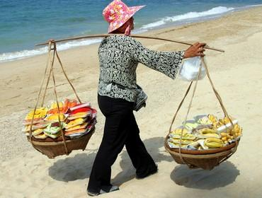 Thai woman selling fruits on beach